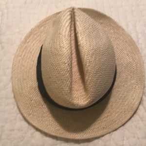 Straw hat with black ribbon.